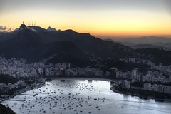 Christ the Redeemer overlooking the Rio's bay (C Moret') Tags: city sunset brazil southamerica riodejaneiro bay seesight couchdesoleil brésil baiederio