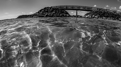 Cool water reflections. (CWhatPhotos) Tags: pictures bridge blue light sea sky blackandwhite costa sun white holiday fish black hot reflection eye water monochrome canon reflections that de lens photography eos prime mono bay blackwhite spain focus warm skies foto view shot angle image artistic time pics fuerteventura low jerry wide picture bridges sunny down pic images september fisheye have photographs photograph fotos 7d manual sept canaries which contain hol caleta 65mm aspherical opteka 2013 fuste cwhatphotos