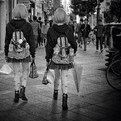 Twin Friends (Tokyo, Japan. Gustavo Thomas  2013) (Gustavo Thomas) Tags: street city girls friends blackandwhite bw blancoynegro monochrome japan walking square japanese tokyo twins shinjuku asia streetphotography teenagers grainy nias amigas bnw adolescentes biancoenero amies tokio gemelas japanesestyle japons blancetnoir monocromtico nocolor monochromatique
