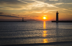 autumn orange (olsonj) Tags: morning lighthouse reflection sunrise lakemichigan kenosha