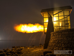 2013-10-18 Vancouver Stanley Park 9 O'Clock Gun-1 (Michael Schmidt Photography Vancouver) Tags: longexposure sky orange brown white black tree beach water yellow fog night grey lights fishing rocks glow explosion boom seawall cannon historical burrardinlet stanleypark hazy bang countdown coalharbour firing automated 9oclockgun downtownvancouver hallelujahpoint discoverynavalbase michaelschmidtphotographyvancouverbc wwwmichaelschmidtphotographycom httpwwwflickrcomphotosdmichaelschmidtsets