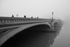 A Foggy Day, In London Town... (A-Lister Photography) Tags: city uk bridge winter light england blackandwhite mist cold reflection london wet westminster silhouette horizontal misty fog thames reflections river landscape lights vanishingpoint still frost alone cityscape shadows silent streetlamp foggy citylife streetphotography dramatic peaceful landmark icon calm silence pedestrians commuting lonely rushhour innercity elegant iconic riverthames stillness atmospheric commuters westminsterbridge reallife cityoflondon winterlandscape realpeople londonicon wetreflections cityworkers coldtemperature iconiclondon mistylandscape adamlister nikond5100 alisterphotography vision:car=0887 vision:outdoor=0858