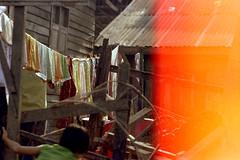 19-170 (ndpa / s. lundeen, archivist) Tags: houses homes house color building film home water 35mm buildings thailand canal bangkok nick canals clothes lightleak thai watersedge clothesline 1970s 1972 19 1973 klong sheetmetal dewolf corrugatedmetal endroll endofroll endoftheroll khlong klongs nickdewolf photographbynickdewolf khlongs reel19