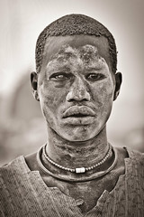 A Mundari male covered in ash and orange hair bleached in the sun from washing it in cow urine. (tommcshanephotography) Tags: africa travel island war cattle cows southsudan tribe wtn crises juba rivernile cattlecamp mundari terekeka tommcshanephotography levwood levisonwood walkthenile