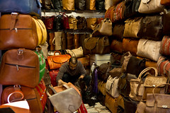 Bag Shop (Mr McCarthy!) Tags: africa man leather shop canon shopping bag market sigma morocco shops souk marrakesh bags sell souks selling souq moroccan shopkeeper souqs 550d