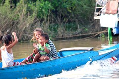 Smile (melanie2wright) Tags: life family blue boy people love water girl youth children happy boat cambodia village child natural melanie young floating compassion enjoy experience laugh siem reap local wright siemreap clap carefree floatingvillage localpeople watervillage melaniewright
