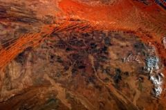 Orange Sand in Africa (sjrankin) Tags: africa orange clouds sand desert edited rocky nasa processed arid sanddunes iss tonalcontrast iss036 6september2013 iss036e38326