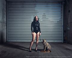 Daydream (LukeOlsen) Tags: usa oregon cat portland concrete feline parkinggarage garage taxidermy latex leash garagedoor pw paxtongate largecat latexsuit strobist lukeolsen pdxstrobist wl1600 latexhoodie