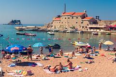 Beach life |   (constantiner) Tags: sea beach island boat colorful tourists bikini streetphoto yachts adriatic montenegro jadran petrovac mediterian    crnagora       mediteran