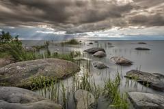 2907-29101 (Robert Björkén (Hobbyfotograf)) Tags: longexposure sea lake water stone stones cliffs shore rev seashore vänern clowds landskap sjö moln stenar lidköping nd400 hindens svalnäs