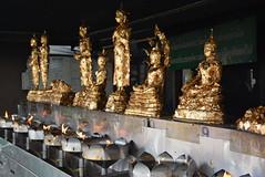 gold leaf-covered buddhas (cam17) Tags: thailand bangkok goldleaf oillamps bangkokthailand buddhastatues oilburners citypillarshrine cityshrine goldleafcovered bangkokpillar buddhasgoldleaf