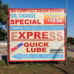 Favorite oil change sign. (Tim Kiser) Tags: 7999 10minoilchange 10minuteoilchange 10minutes 2013 20131014 amsoil annarbormetropolitanarea annarborypsilanti businessushighway12 eastmichiganavenue expressquicklube highway17 highwaym17 img3365 m17 michigan michiganavenue michiganhighway17 michiganroute17 october october2013 route17 routem17 statehighway17 stateroute17 us12businessroute usroute12business valvoline washtenawcounty washtenawcountymichigan ypsilanti ypsilantimichigan allcaps arrow arrowpointingleft bluearrow businessarrows businesssign christmaslights express hours hoursofoperation lube lubebusiness oilchangebusiness oilchangesign oilchangespecial oilchangingbusiness plasticsign quicklube redwhiteandblue redwhiteandbluesign roadsidesign sign southeastmichigan southeasternmichigan stringofchristmaslights transmissionflush uppercaseletters wecarryallmajorbrands unitedstates