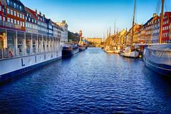 Sunrise in Nyhavn in Copenhagen, Denmark (` Toshio ') Tags: toshio copenhagen denmark nyhavn sunrise harbor sunlight danish europe european europeanunion ships tallships boat barge restuarants fujixe2 xe2