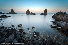 The sea of Malavoglia - Acitrezza 01 - Sicily (Alessandro Barcellona Photography) Tags: ocean trees light sunset sea sky italy seascape mountains beach nature water clouds landscape photography coast landscapes nikon rocks italia mare seascapes picture natura images verona sicily fotografia lombardia sicilia barcellona fotografo alessandro veneto