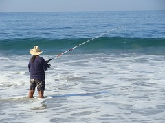 The Fisherman (knightbefore_99) Tags: ocean fish west beach mexico coast fisherman pacific wave playa mexican tropical zihuatanejo guerrero