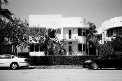 Art Deco Apartments South Beach (Phillip Pessar) Tags: camera bw white black building art film beach architecture analog 35mm store apartments florida zoom kodak miami infinity tx south trix olympus x thrift 400 tri deco 70 sobe