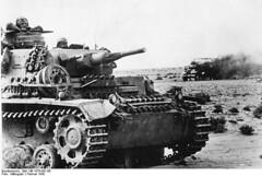 German panzer III tank with burning British lorry.