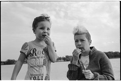 Sunflower seeds (Marcin Winios) Tags: blackandwhite bw woman lake girl monochrome outdoor daughter mother filmphotography