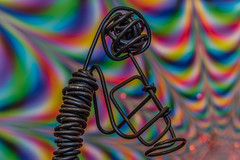 Trumpeter and his colorful music world (Hanna Tor) Tags: macro pattern art bokeh trumpeter macromonday madeofmetal 7dwf crazytuesdaytheme maketheworldmorecolorful hannator explore metal texture background multicolored colorful detail