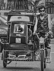 Pedicab of Love (FotoGrazio) Tags: asian composition malate travelphotography pinoy photographicart internationalphotographer worldphotographer man contrast taxi waynegrazio transportation manila business riding pedicab makingaliving hardwork bicycle lifeinthephilippines waynesgrazio streetscene drive people californiaphotographer digitalphotography topazadjust flickr philippines transporation adobephotoshop sandiegophotographer adobelightroom topazclarity fotograzio photographicartist ride driving sunglasses male filipino pacificislander streetphotography photography blackandwhite driver working