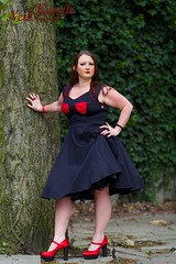 IMG_4493 (Neil Canon Keogh) Tags: red black vintage necklace highheels dress retro ring redhead bow buskers bracelet heels rockband pinup pinupgirl trianglesquare manchestercitycenter dressmodellaura