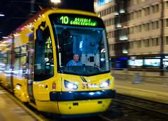 Tram Arrival, Warsaw, Poland (spchampion) Tags: city red urban yellow night train publictransportation tracks tram poland transportation warsaw
