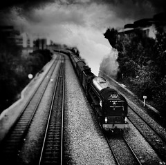 Cathedrals Express (Skipology) Tags: camera blackandwhite bw texture monochrome train square blackwhite track engine rail railway steam lincoln steamengine steamtrain blend iphone tiltshift rainydaze textureblend iphoneography snapseed