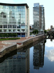 Tower block reflection at Manchester (Tony Worrall Foto) Tags: street city uk england urban reflection tower wet water buildings river manchester hotel tour north visit block built offices shimmer gmr greatermanchester 2013tonyworrall