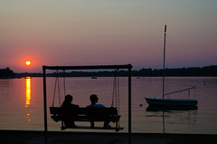 Sun, Couple, Swing, Boat (topmedic) Tags: sunset lake sailboat boat couple swing crystallake mainbeach
