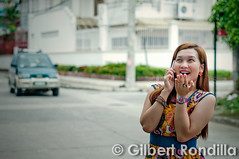 Gossip girl (Gilbert Rondilla) Tags: city family urban woman smile smiling female asian happy healthy phone vibrant philippines capital smiles cellphone happiness listening national manila filipino pinay filipina jolly gadget talking joyful tablet region connectivity connection pinoy gossip asianethnicity valenzuelacity