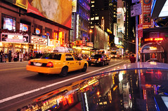 On the way to Times Square (Nelly Matray) Tags: street new york city light usa car yellow night america jaune advertising pub nikon theatre lumire cab taxi voiture reflet reflect rue nuit ville d5000
