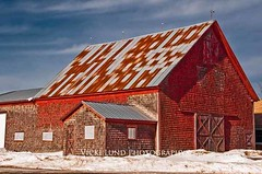 Big Red Shingled Barn (Vicki Lund Photography) Tags: naturallight newengland northamerica nikond90 newenglandphotography nikon maineartist mainephotographer maine mainenewengland travelphotographer winter wwwvickilundphotographycom httpaboutmevickilundphotography httponfbmevickilundphotographywelcome fineartlandscape fineartprints freelancephotographer fineart buildings barns redbarns shingledbarns shingled blue red snow countryroads vickilundmaine vickilund view barndoor turner winter new england