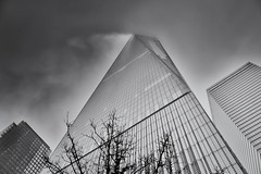 One World Trade Center (Winning Agent) Tags: world newyorkcity sky blackandwhite newyork storm building glass skyline architecture clouds contrast skyscraper one pattern fuji worldtradecenter perspective center skyward trade silverefx x100t fujix100t