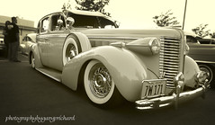 1938 Buick Century (CameraOne) Tags: auto california car sepia lumix evening buick twilight classiccar automobile sundown dusk 1938 spokes panasonic pointandshoot fontana sanbernardino luxurycar roadmaster pocketcamera whitewalltires wirewheels buickcentury cameraone lumixzs19