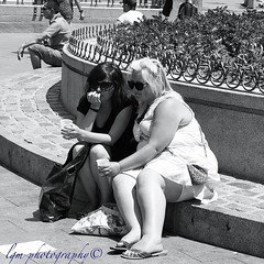 Two Women at Puerta del Sol (Halcon122) Tags: madrid street friends urban bw sunglasses women couple downtown raw afternoon candid streetphotography stranger blonde puertadelsol