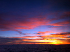 2013_12_20_lax-iah-iad_42h (dsearls) Tags: pink blue sky orange yellow clouds sunrise flying texas purple aviation united flight violet aerial ual stratus iah cirrus unitedairlines windowseat windowshot altostratus 20131220 laxiahiad