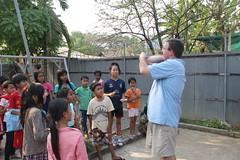 "Greg entertaining the kids at at Kids Club Battambang <a style=""margin-left:10px; font-size:0.8em;"" href=""http://www.flickr.com/photos/46768627@N07/13295634423/"" target=""_blank"">@flickr</a>"