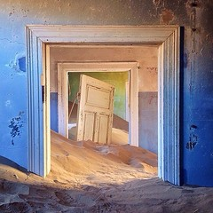 Since its abandonment in 1954, the once-booming mining town of Kolmanskop has gradually succumbed to the sands of the Namib Desert. The small town near the coast of Namibia was built in the style of a German village following the discovery of diamonds in (ashlibean) Tags: from above blue its by architecture contrast diamonds hospital for was coast town photo theater european village view desert photos near sandy text small ghost style 1954 it location casino since mining more german destination to tap sands stark today picturesque discovery towns namibia making has abandonment videos height surroundings built decayed stands following 1908 namib the succumbed adventurous gradually kolmanskop boasted thefella instagrammers oncebooming