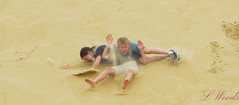 Hilarious Accidents (luckycoinz) Tags: funnyface silly kids canon children ouch nc hilarious sand funny accident priceless sanddune outerbanks rolling collide embarrassing shutterspeed shutterpriority lwoods luckycoinz