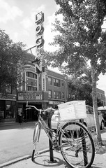 Parked and Locked in Logan Square (Fogel's Focus) Tags: chicago coffee bike bicycles diafine logansquare acros intelligentsiacoffee ricohgr1v 4545 logantheater film:iso=100 legacypro100 acufinediafine developer:brand=acufine developer:name=acufinediafine film:brand=freestylearista freestylearistalegacypro film:name=freestylearistalegacypro100 parkedandlocked filmdev:recipe=8912