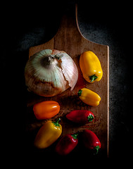 Kitchen (Steven Schnoor) Tags: stilllife color art canon still cool colorful peppers onion ernie cuttingboard sweetpeppers schnoor simplelogic sweetyellowonion thunderoutside