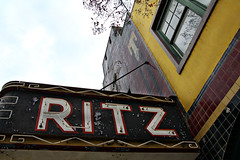 Ritz (Samantha Evans of Samantha Evans Photography) Tags: blue red sky white black building tree green window glass leaves yellow wall architecture clouds canon ga buildings georgia tile word leaf berry theater neon branch berries architecturaldetail name letters tiles ritz neonsign smalltown thomaston tamron1750 canon60d thomastonga