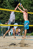 Two male beach volleyball players jumping at the net for a ball (onnobos) Tags: blue summer wallpaper people sun man net sports sport canon fun happy interestingness smash interesting team jump sand focus action top swiss background sunny playa beachvolleyball explore human backgrounds 5d volleyball block wallpapers athlete volley foley interesantísimo teamvolley sportsactionshot alersheimbeachvolleybalcup2013