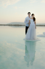 bridegrooms on dead sea (romanato roberto) Tags: sea water reflections dead israel mar nikon sale salt husband 200 wife roberto 18 acqua riflessi sposa morto sposi israele moglie bridegrooms marito vrii romanato