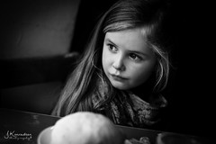 Thoughtful (JKonradsen Photography) Tags: portrait blackandwhite bw window face look kid cafe eyes thought mood child expression think thoughtful naturallight thoughts thinking lowkey windowlight