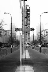 mirror (Darek Drapala) Tags: street city blackandwhite bw reflection building buildings lumix mirror blackwhite poland polska panasonic warsaw g2 warszawa doubled panasonicg2 vision:street=0778 vision:outdoor=0914