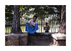 man in a vivid longyi (jrockar) Tags: street city travel people urban 3 man color colour canon photography asia bright mark yangon burma iii documentary vivid madness l 5d myanmar southeast ef f4 1740 position mk weir ordinary f4l ordinarymadness guylongyi