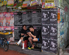 """""""the kills"""" (hugo poon - one day in my life) Tags: gfx50s 63mm hongkong causewaybay gloucesterroad shop vacant time kill killtime companions two break thekills poster bicycle phone games friends"""