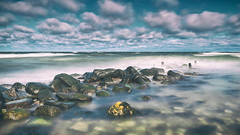 Rough sea (Stefan Sellmer) Tags: schleswigholstein wind spring wow water germany mood outdoor balticsea clouds nikfilter longexposure beach waves balticcoast light coast sunshine seascape rocks kiel weekend seaside strande deutschland de