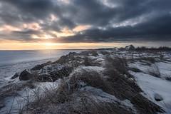 Warming up (Alec_Hickman) Tags: seascape ice snow winter freeze frozen sunrise colors house cottage clouds sky canada grass